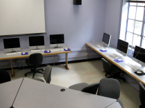 computer classroom with chairs and desks