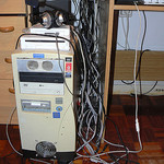 old tower computer with mess of cables and peripherals